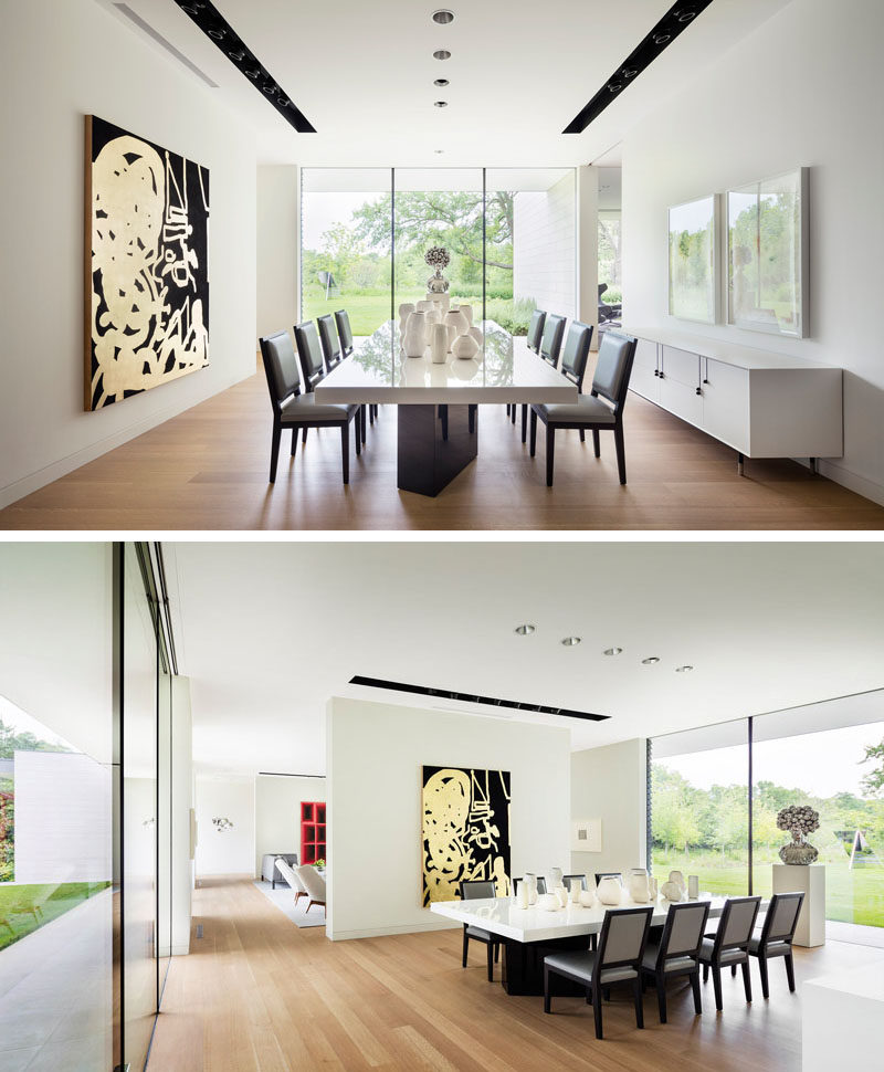 Large white walls reminiscent of a gallery, are used throughout this modern house to highlight the artwork. #DiningRoom #InteriorDesign