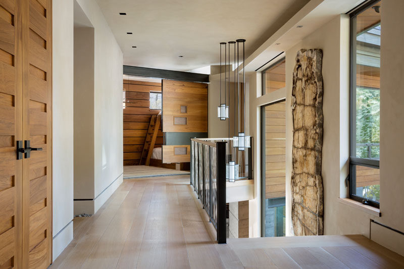 Various wood doors feature throughout this contemporary lakeside home. #WoodDoors #Doors