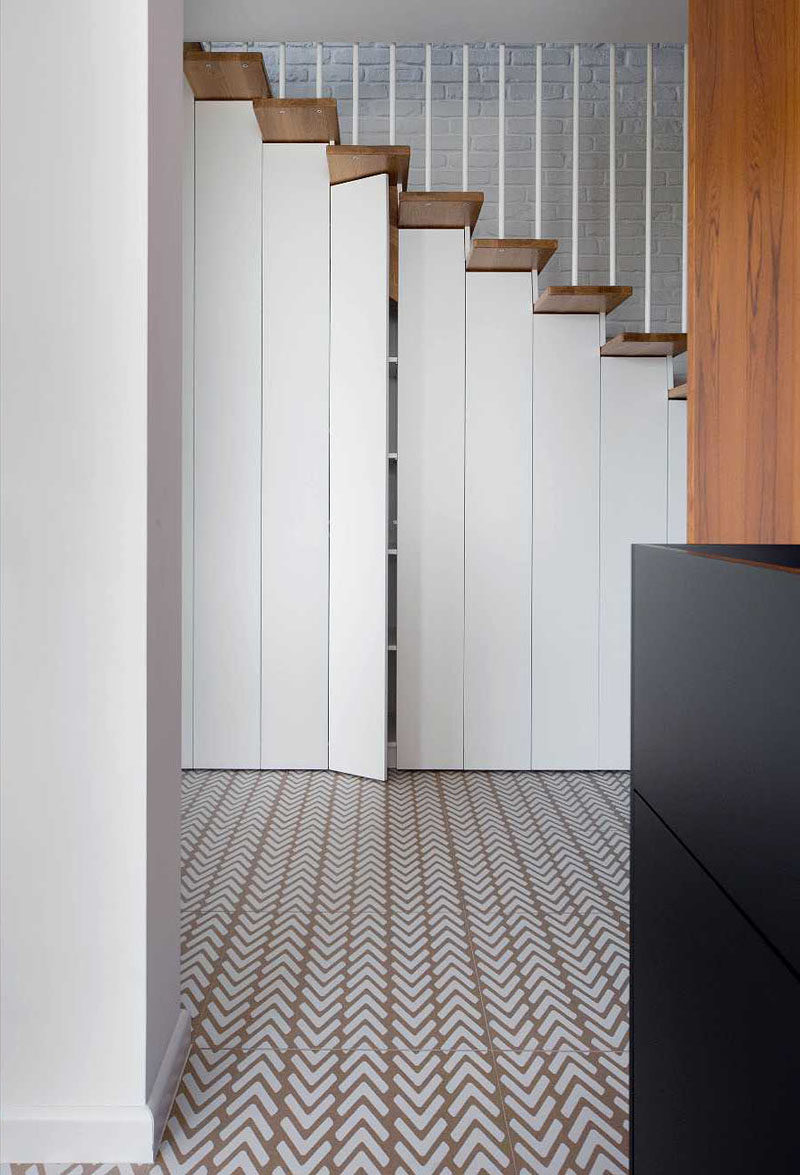 Patterned tile flooring was used to help define the kitchen and hallway in this modern house. #PatternedFlooring #TileFlooring #PatternedTile
