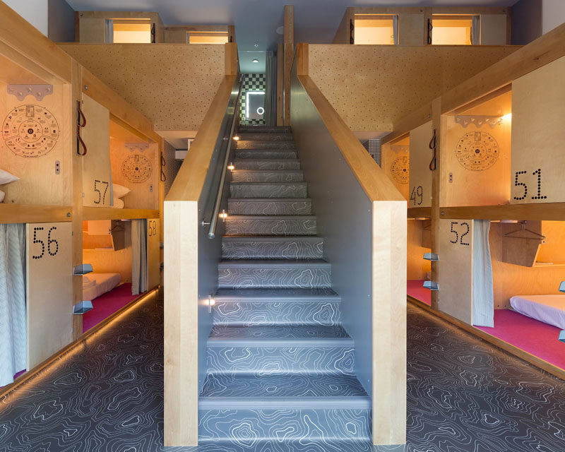 Vancouver-based firm Bricault Design have recently completed the newly opened Pangea Pod Hotel in Whistler, Canada, that features a bar, storage room, and small sleeping pods. #Whistler #ModernHotel #PodHotel #InteriorDesign #HotelDesign #Stairs