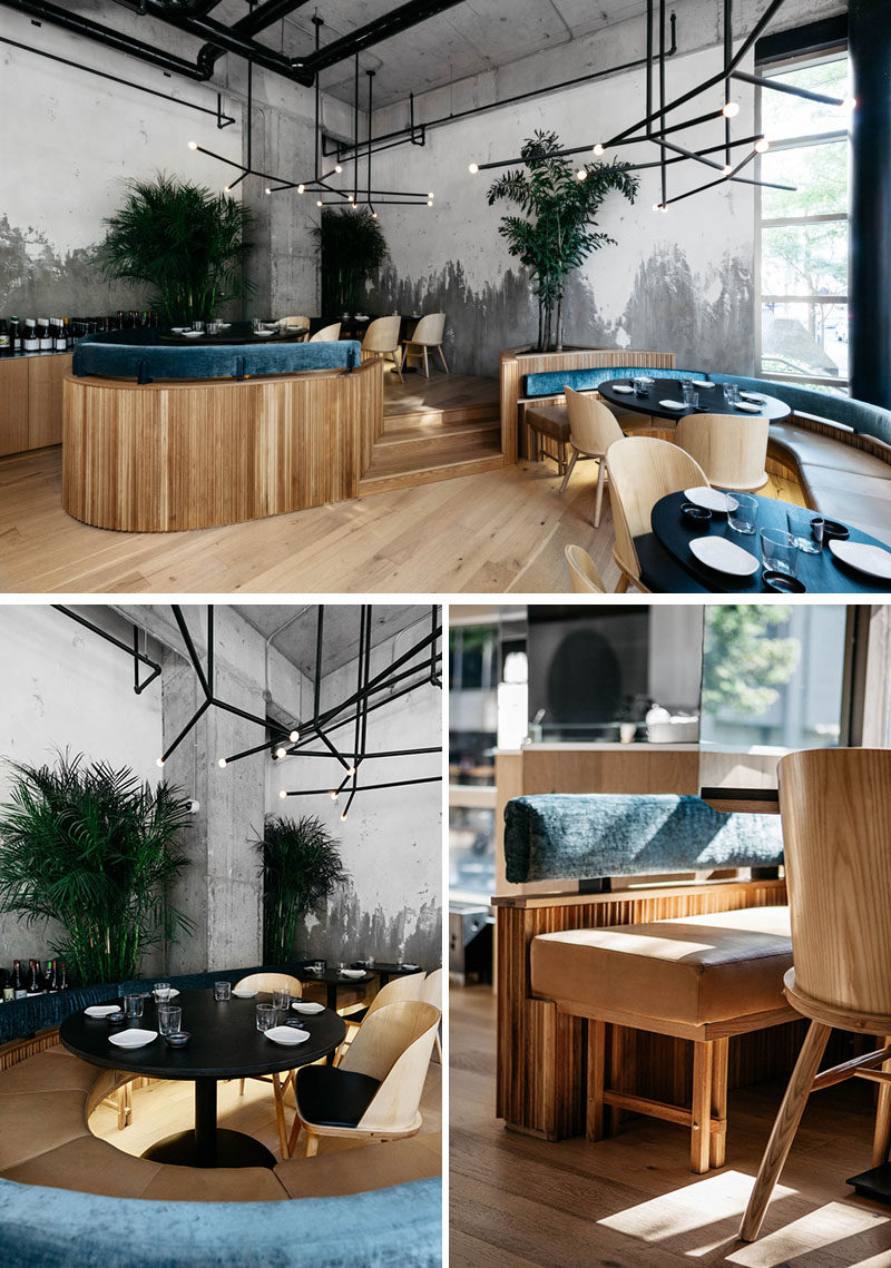 This modern restaurant has a slightly raised seating area to accommodate for small groups. #Restaurant #RestaurantDesign #RestaurantSeating