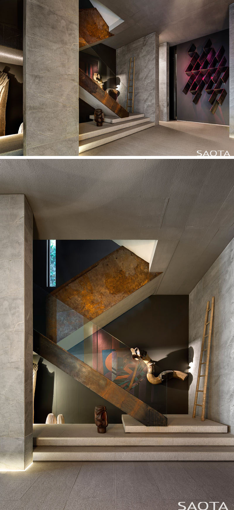 This modern house has a double volume art-filled entrance foyer that has a rusted steel and glass staircase. #EntranceFoyer #ModernInterior #Stairs #RustedSteelAndGlassStairs