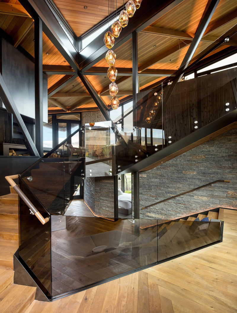 A wood staircase connects the levels of this modern mountain house. #ModernStairs #StairDesign #Staircase