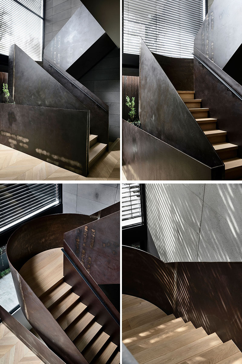 Modern steel and wood stairs that lead to the upper level of this house. #ModernSteelStairs #SteelAndWoodStairs #StairDesign