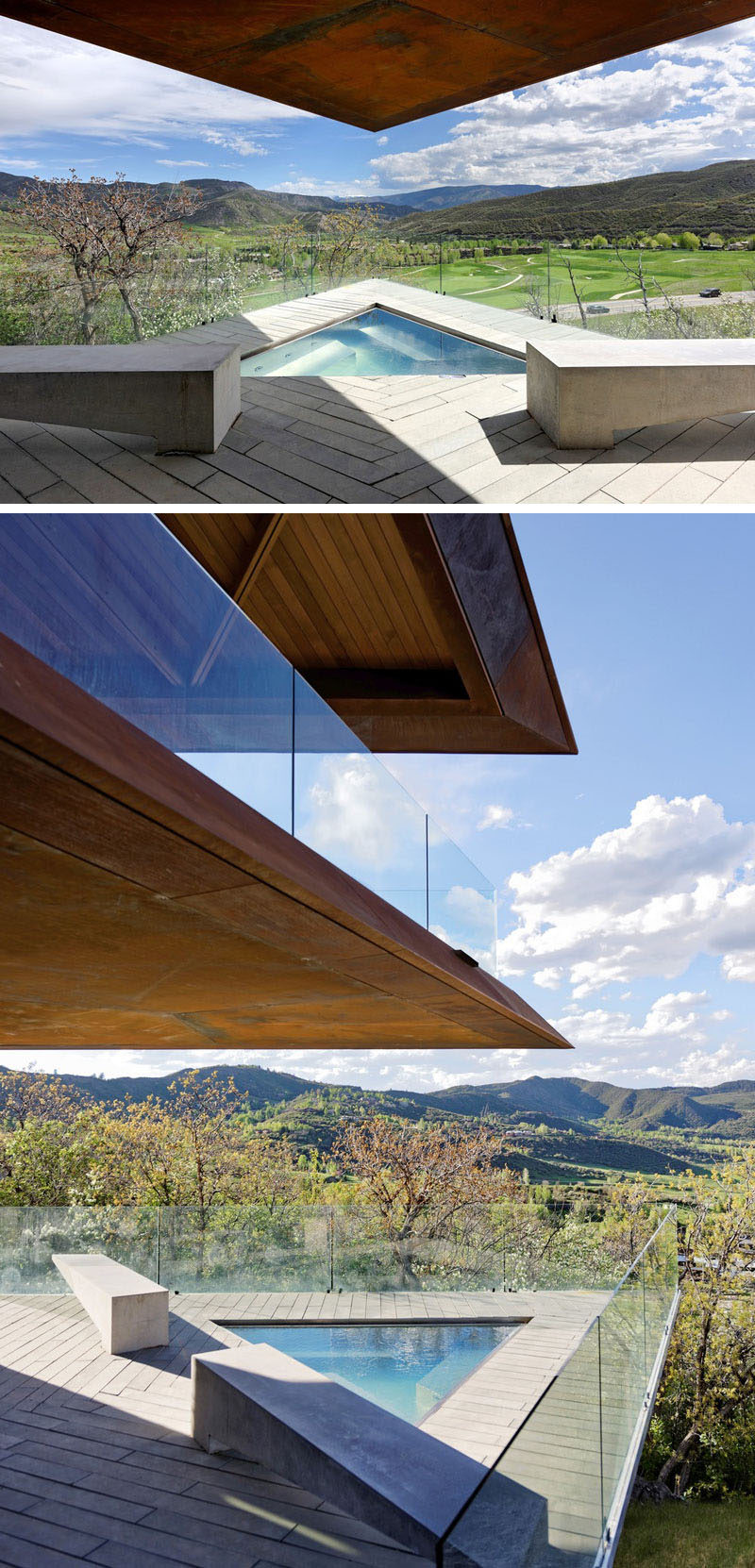 This modern mountain house has a cantilevered section of the main floor that creates a cover for a triangle-shaped spa. #Spa #Cantilever #Architecture