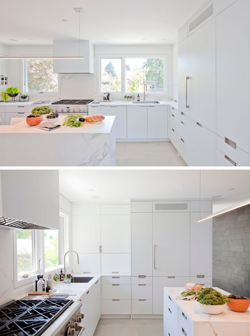 This modern kitchen is bright and airy due to the use of minimalist white cabinetry, lighting and the natural lighting from the windows. #WhiteKitchen #KitchenDesign