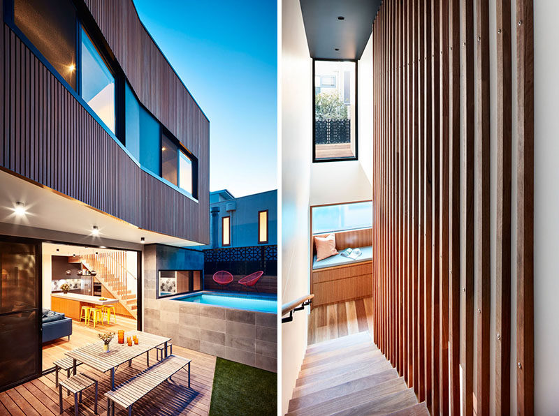 This modern house has a window seat at the bottom of the stairs that looks out to the pool, and the wood slats of the stairs continue up to the ceiling as a decorative wall feature. #ModernHouse #Stairs #WindowSeat