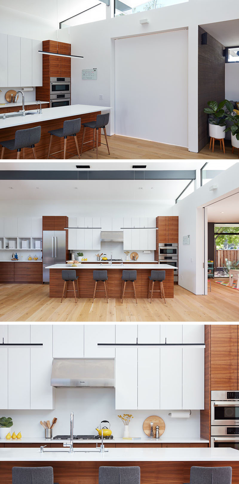 A sliding door can close off the playroom from the main social areas of the house. In the kitchen, white minimalist cabinets have been paired with wood elements. #ModernKitchen #KitchenDesign #WoodAndWhiteKitchen