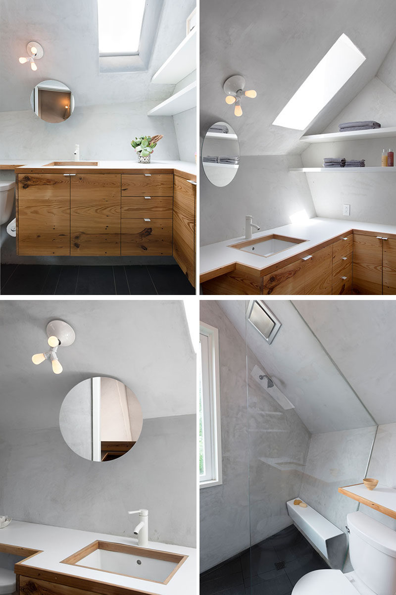 A skylight helps to brighten this small bathroom and add natural light, while a floating mirror is located above the vanity, and in the shower, there's a floating shower bench. #ModernBathroom #BathroomDesign #Skylight