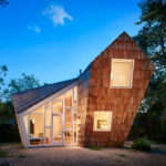 Shingle Clad Angled Walls Were Used In The Design Of This Small House