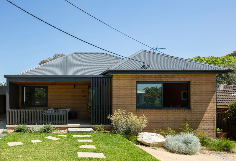 Christopher Polly Architect have recently completed a modern black rear extension to an original 1960's yellow brick house in Sydney, Australia. #AustralianHouse #BrickHouse