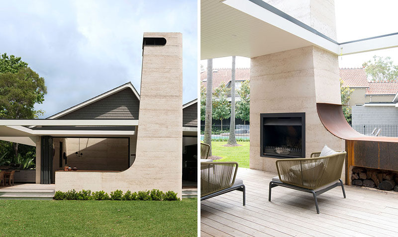 This house has a 22 foot (7m)high rammed earth chimney for an outdoor fireplace that sits beside an open air living room. #Fireplace #OutdoorFireplace