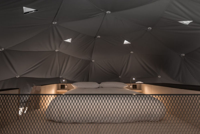 This dome has a boat staircase that leads to a second bed on a wood platform. #PlatformBed #Dome