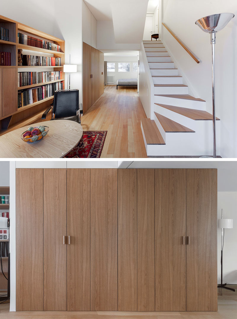This small and modern apartment hides the kitchen, storage, and a laundry within a wood closet in the hallway. #InteriorDesign #SmallKitchen #HiddenKitchen #HiddenLaundry