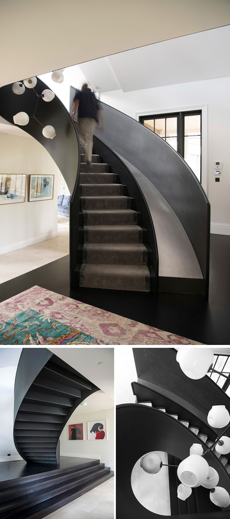 This modern house has a curved steel staircase with a slide that connects the main floor with the upper level, that's home tothe kids' bedrooms and a rumpus / playroom.#Stairs #StairsWithSlide #Staircase