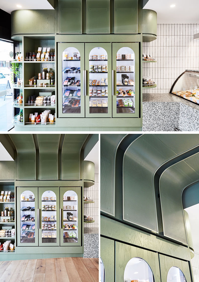 This modern butcher features backlit fridges with arched details, open shelving, and a curved ceiling detail that wraps from one side of the butcher, up onto the ceiling, and down to the opposite wall. #ModernButcher #RetailDesign #RetailDisplay #InteriorDesign