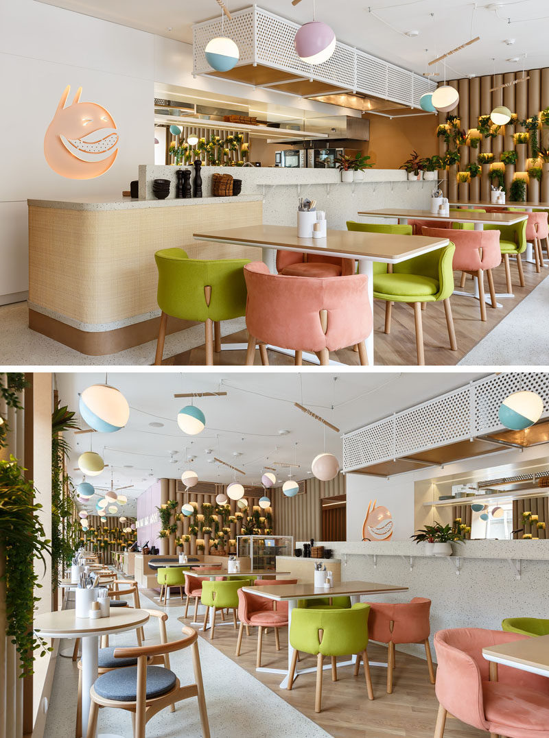 Light purple, blue, lime green, and pink have been used to add pops of color to the design of this modern restaurant. #RestaurantDesign #InteriorDesign #ModernRestaurant