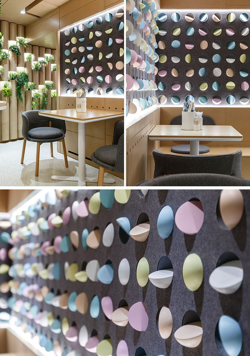 The walls of this modern restaurant are have wall niches decorated with colorful Mochi-shaped elements. #WallAccent #ModernRestaurant #InteriorDesign