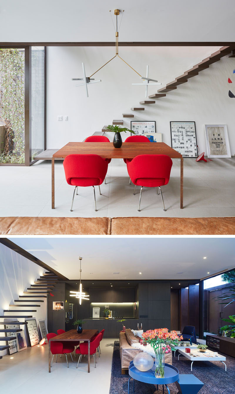 Bright red dining chairs and blue side tables add pops of color to this modern living room and dining room. #InteriorDesign #DiningRoom #LivingRoom