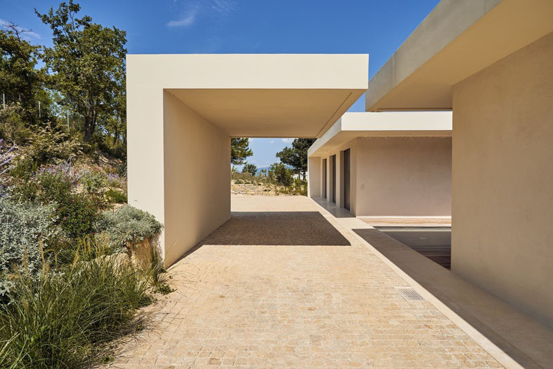 This modern house has a carport that hangs over the driveway. #Carport #Architecture