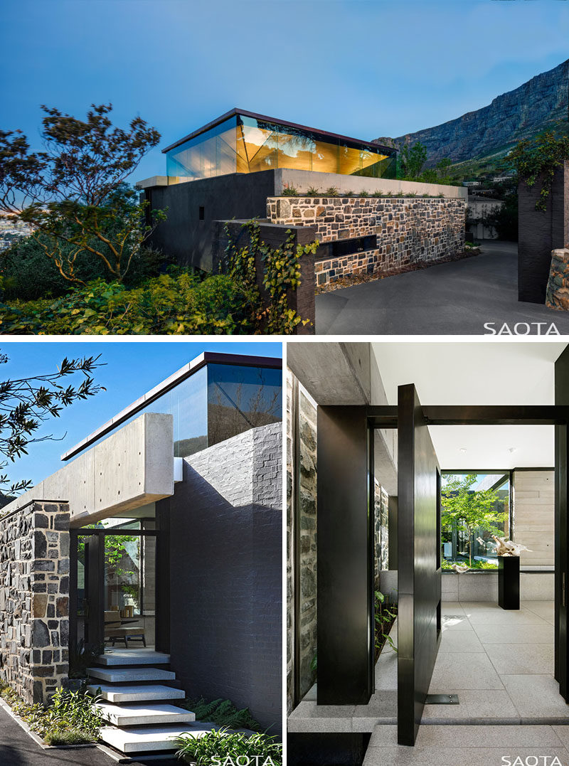 This modern house has been designed withan inverted pyramid roof, which creates a clerestory window around the upper level, while a large metal pivoting front door welcomes visitors to the home. #ModernHouse #Architecture #HouseDesign #FrontDoor #Windows