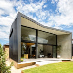A Black Rear Extension Was Added To A 1960's Brick House In Sydney