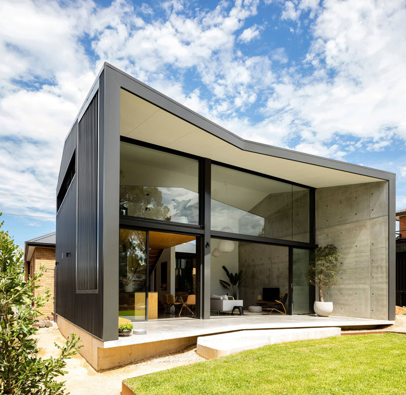 Christopher Polly Architect have recently completed a modern black rear extension to an original 1960's yellow brick house in Sydney, Australia. #ModernHouseExtension #ModernArchitecture