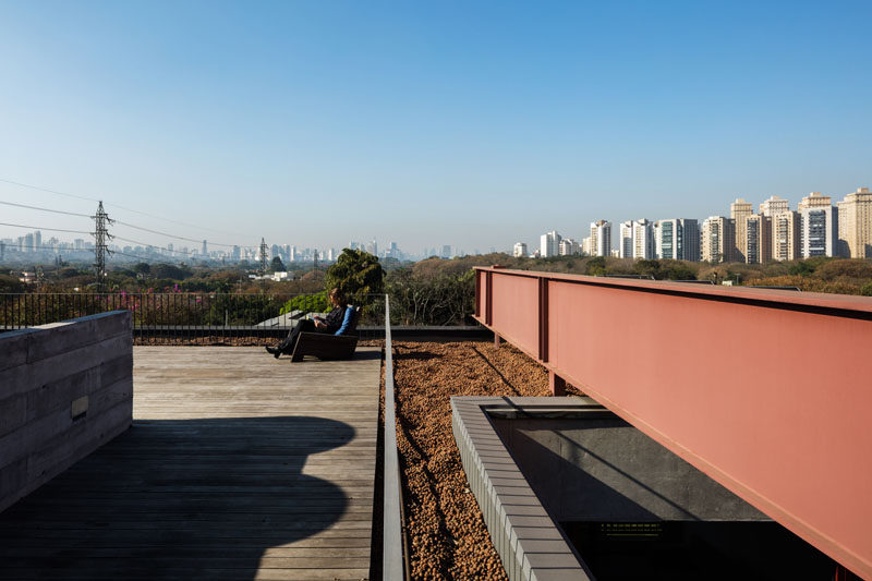 This modern house has a rooftop deck that overlooks nearby wetlands. #Architecture #RooftopDeck