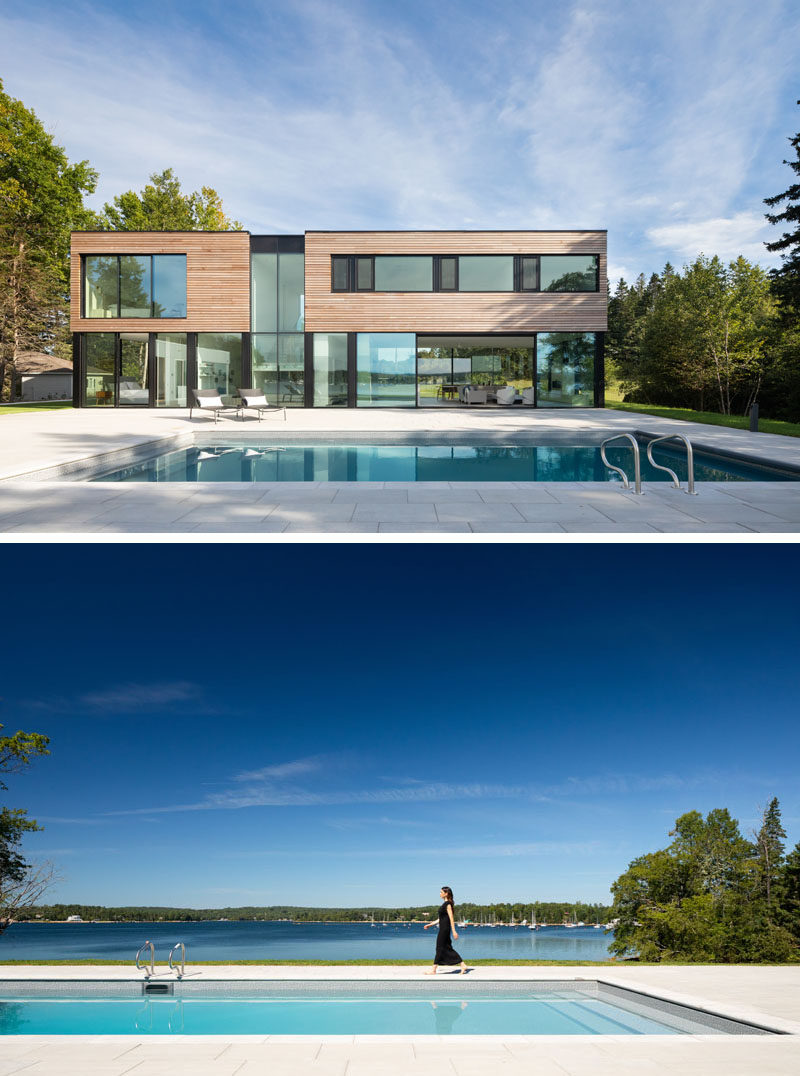 Massive sliding glass panels allow the heart of this modern house to open up to the swimming pool and deck. #ModernHouse #SwimmingPool #GlassWalls