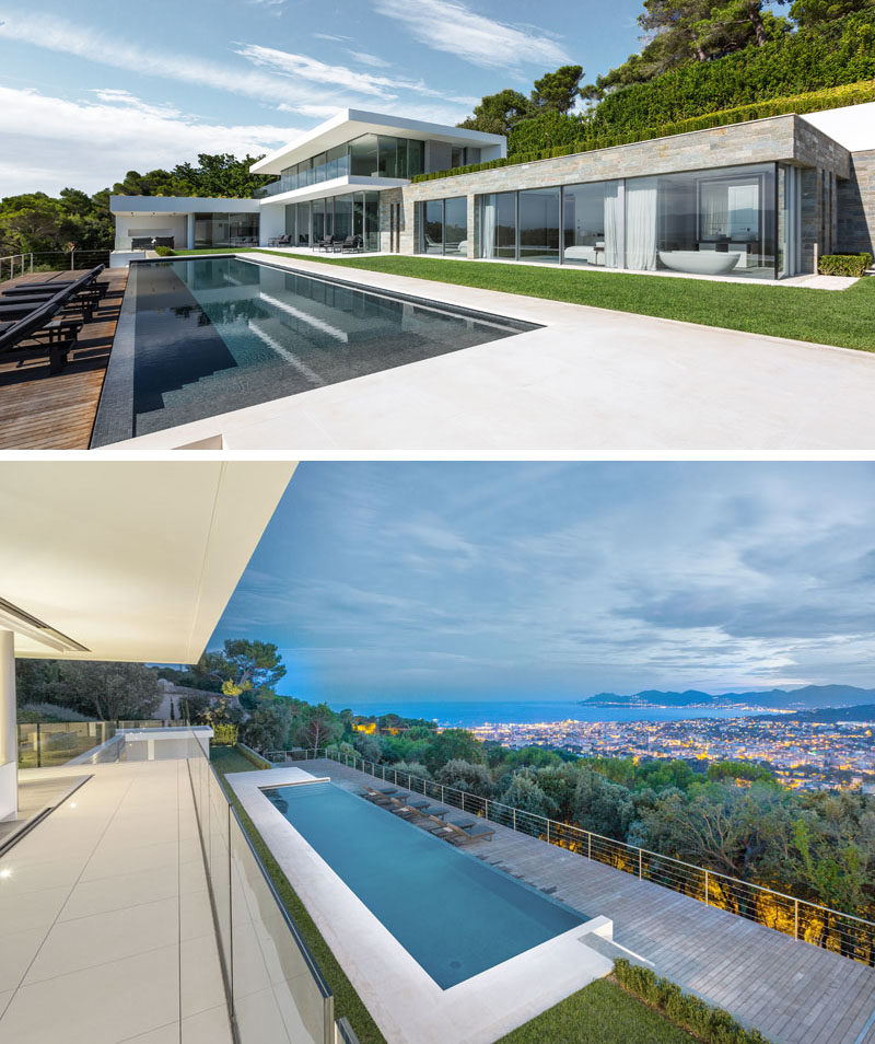 The main floor of this modern house opens up to a 20 meter long infinity pool, that has a lower deck to allow for uninterrupted views from the house. #ModernHouse #SwimmingPool #Landscaping