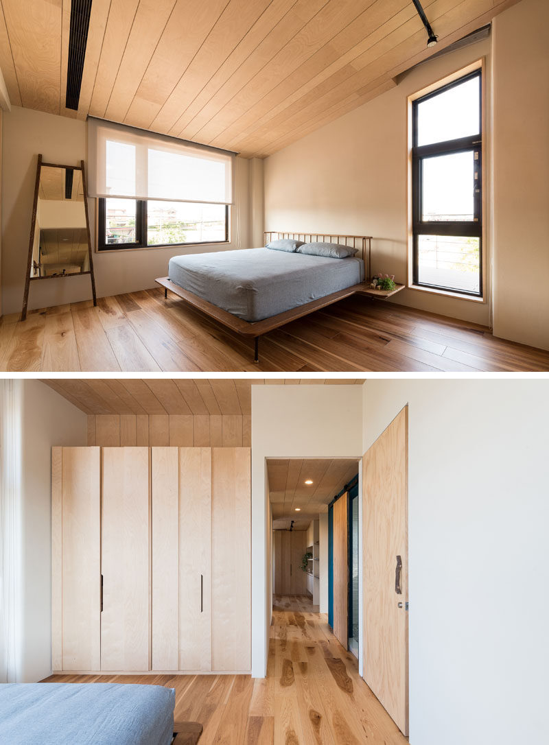 This modern bedroom has been kept simple in its design, with wood flooring and neutral colored walls. #ModernBedroom #BedroomDesign