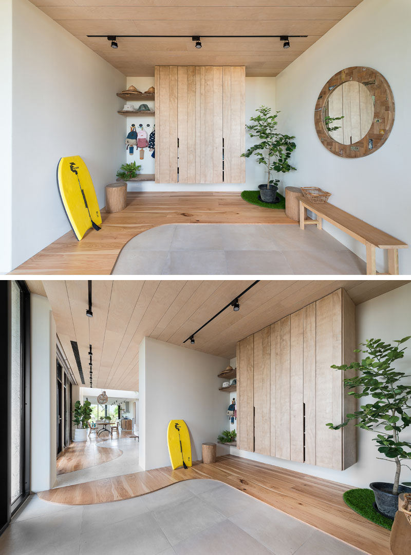Stepping inside this contemporary house and there's a entryway with open shelving, a closet,and a bench. #Entryway #Foyer #ContemporaryInterior #InteriorDesign