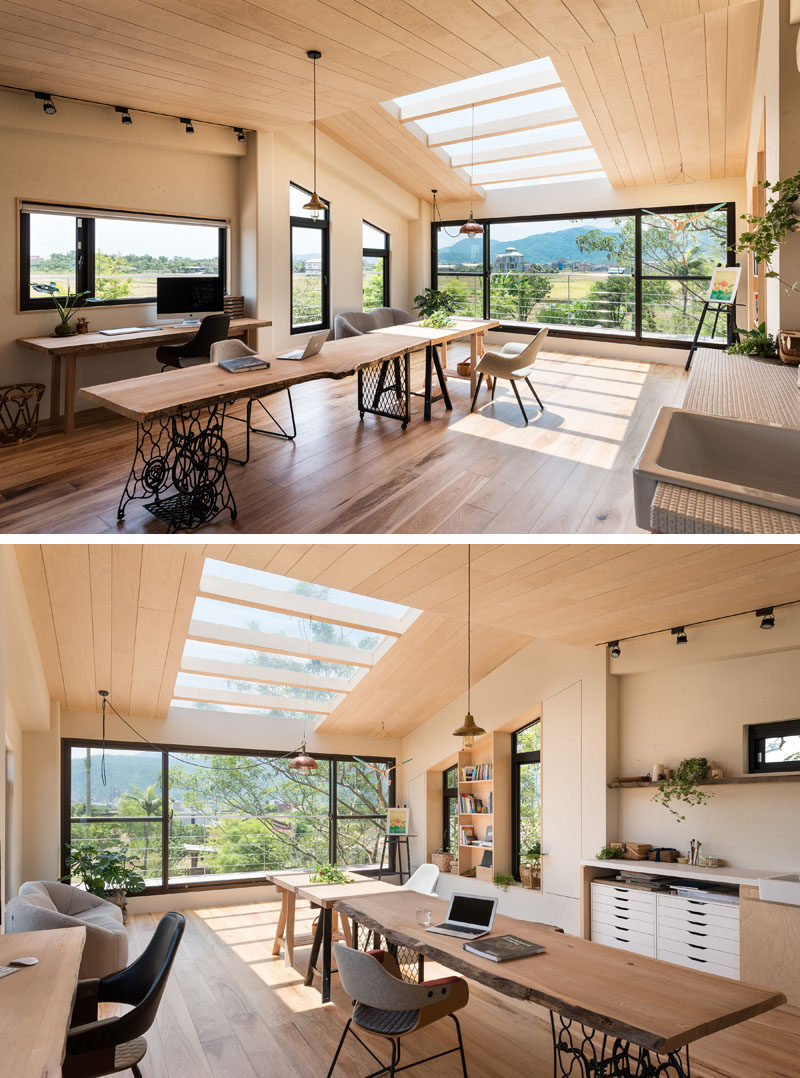 Plenty of windows in this lofted studio provide views of the farmland outside, and skylights provide plenty of natural light. #Studio #HomeOffice #Windows #Skylight