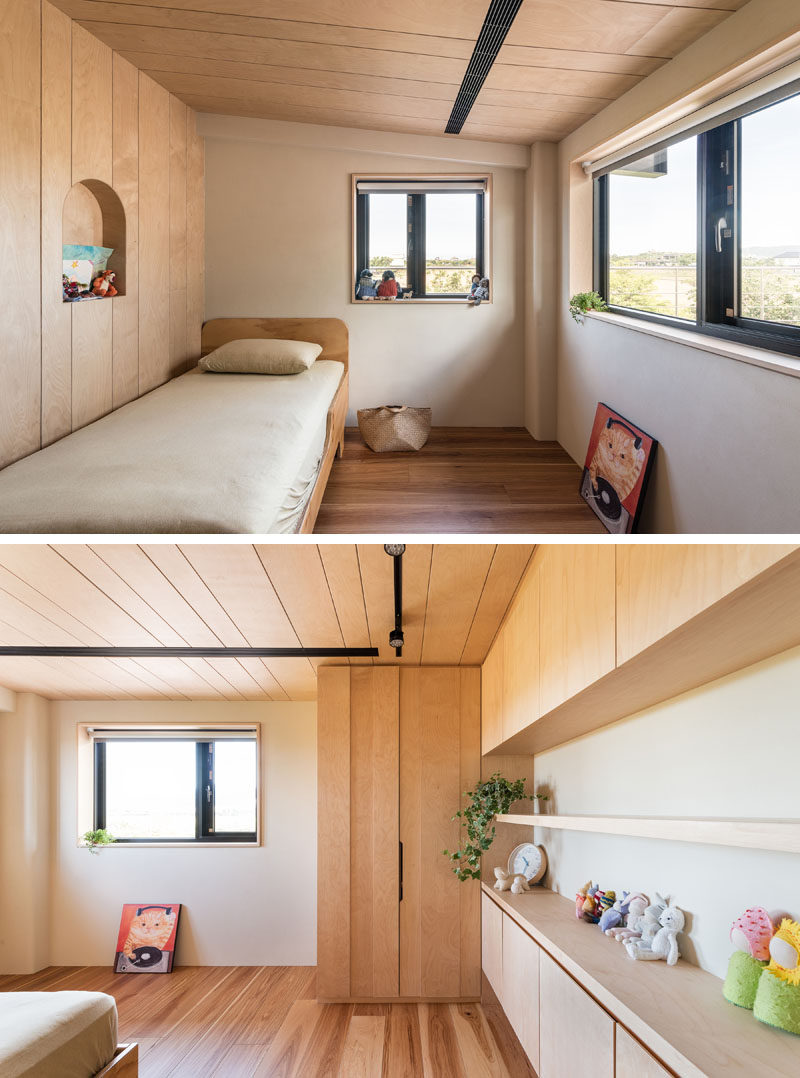 In this modern child's bedroom, a small alcove has been cut out from the wall, while built-in wood cabinets and shelving runs along the wall. #KidsBedroom #BedroomDesign