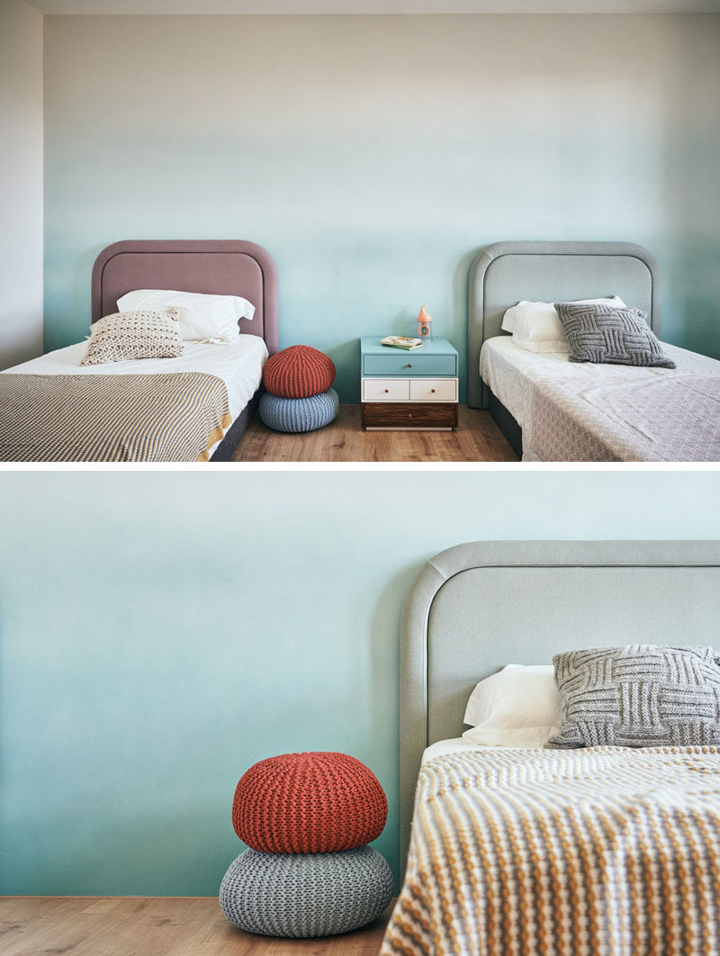 This modern bedroom features a soft colored accent wall. #ModernBedroom #BedroomDesign