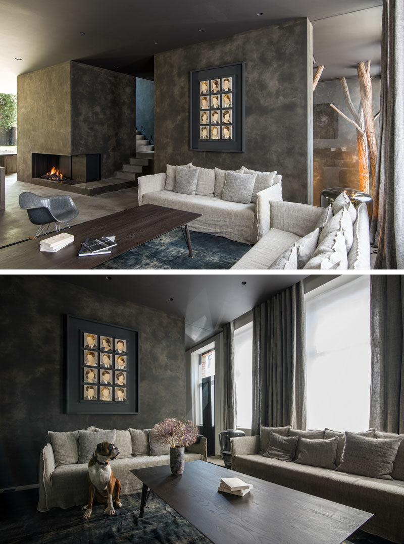 This contemporary living room has a fireplace and windows that look out towards the street. #LivingRoom #Fireplace