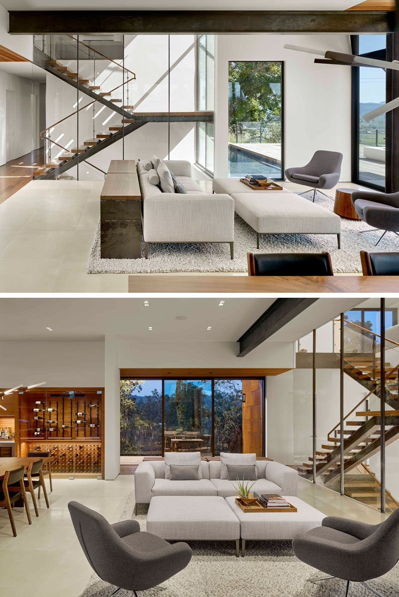 Inside this modern house, light colored walls and plenty of windows help to keep the living room bright and airy, while exposed steel beam give a slight industrial feel to the interior. #LivingRoom #InteriorDesign