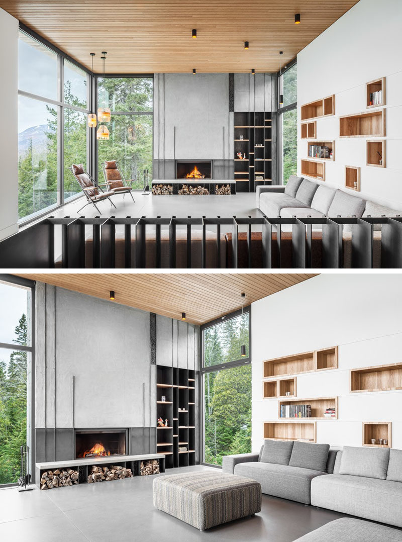 This modern living has built-in wood lined shelving above the couch, while on the adjacent wall is addition shelving and a concrete fireplace. #LivingRoom #BuiltInShelving #Fireplace #Windows