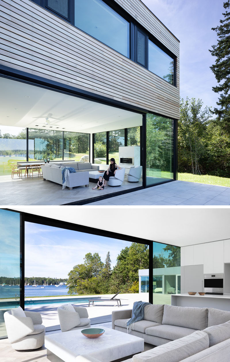This modern house has large floor-to-ceiling sliding glass doors that open the interior to the swimming pool and deck. #GlassDoors #InteriorDesign #GlassWalls