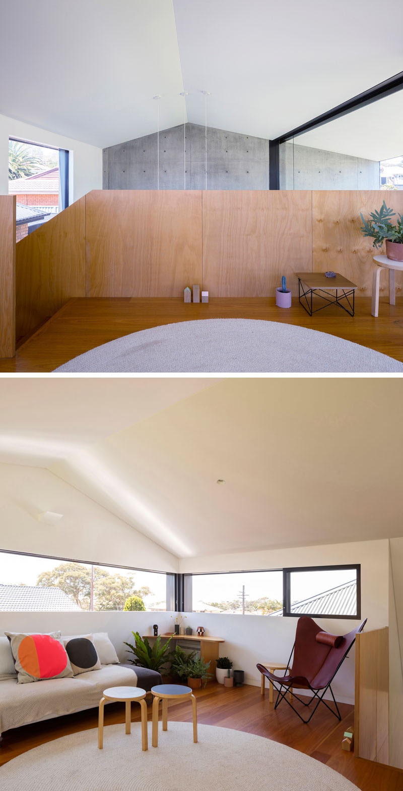 This modern house features a lofted living area that overlooks the main living room below. #LivingRoom #Loft