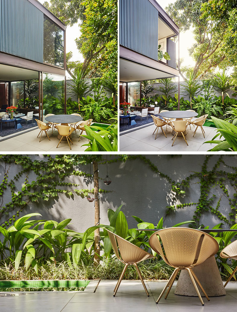The second floor of th is modern house appears to almost float above the main floor, when the sliding glass doors are open. Tropical landscaping has been used to soften the concrete privacy walls. #ModernHouse #TropicalLandscaping #LandscapeDesign