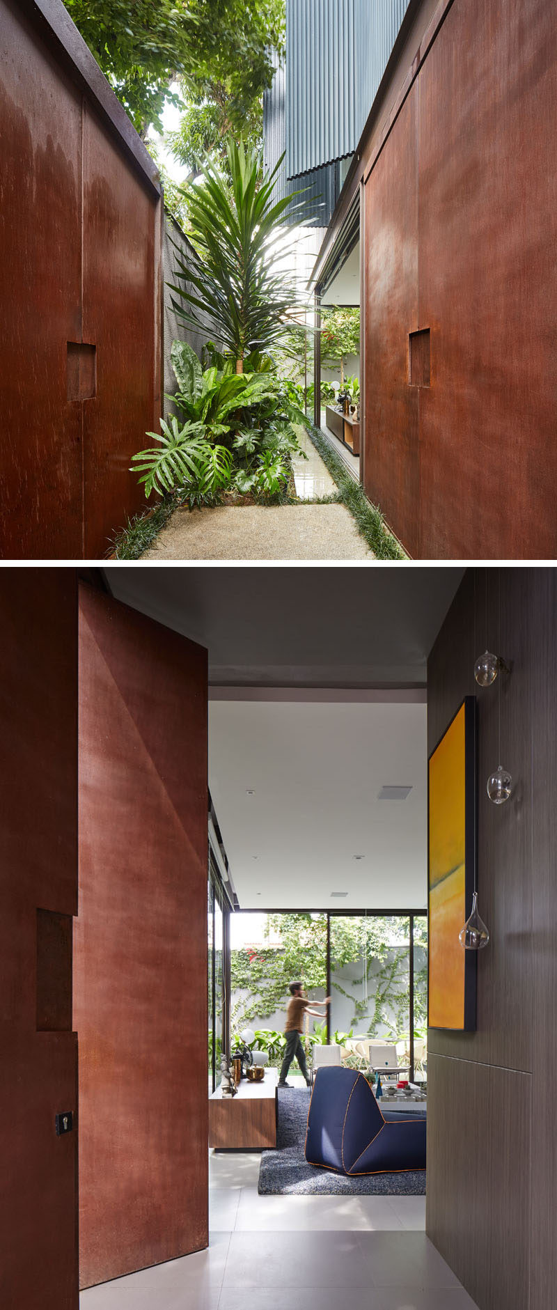 The large weathering exterior steel gate on this modern house opens to reveal an entryway with a garden and access to the interior through additional weathering steel pivot doors. #WeatheringSteelDoors #FrontDoor #Garden
