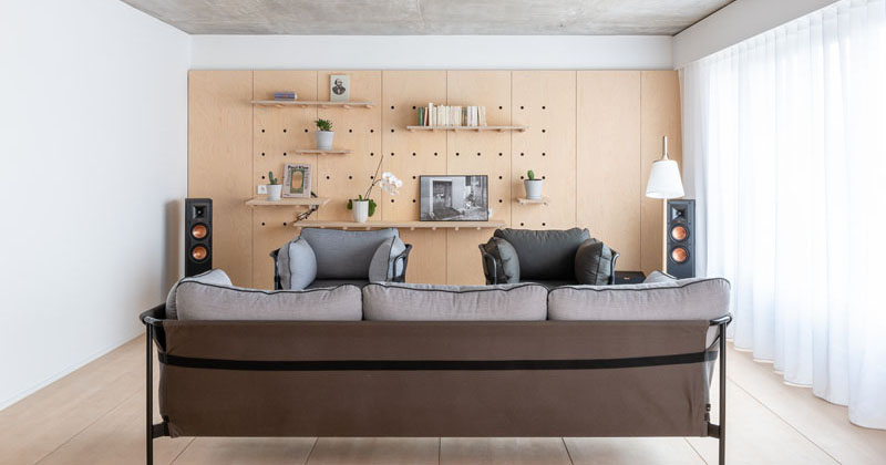 Design Detail - Peg Board Walls Have Been Used To Create Flexible Shelving In This Apartment