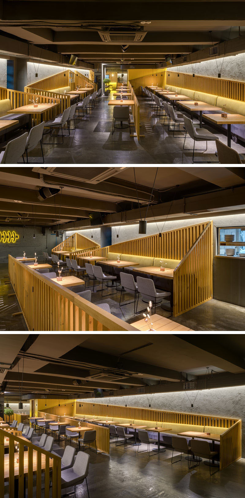 The seating in this modern restaurant and bar is designated with angled wood slat partitions, while banquette seating lines the walls, and hidden lighting gives a soft glow to the dining room. #RestaurantDesign #Interiors #BarDesign