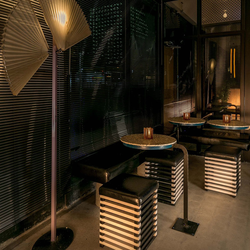 This modern Japanese restaurant interior has a small seating area with casual tables, benches, and stools. #Seating #RestaurantDesign