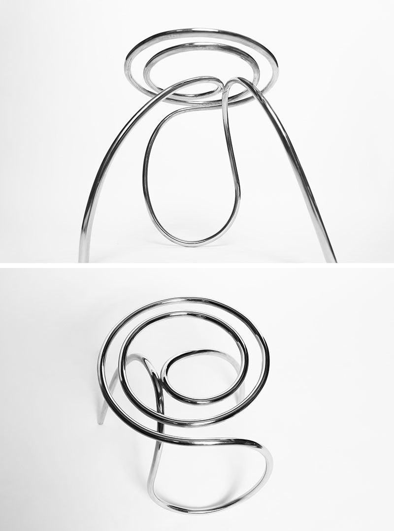 XYZ Integrated Architecture have designed a unique and sculptural stool, that's made from curved stainless steel. #Seating #Stool #Furniture #Design