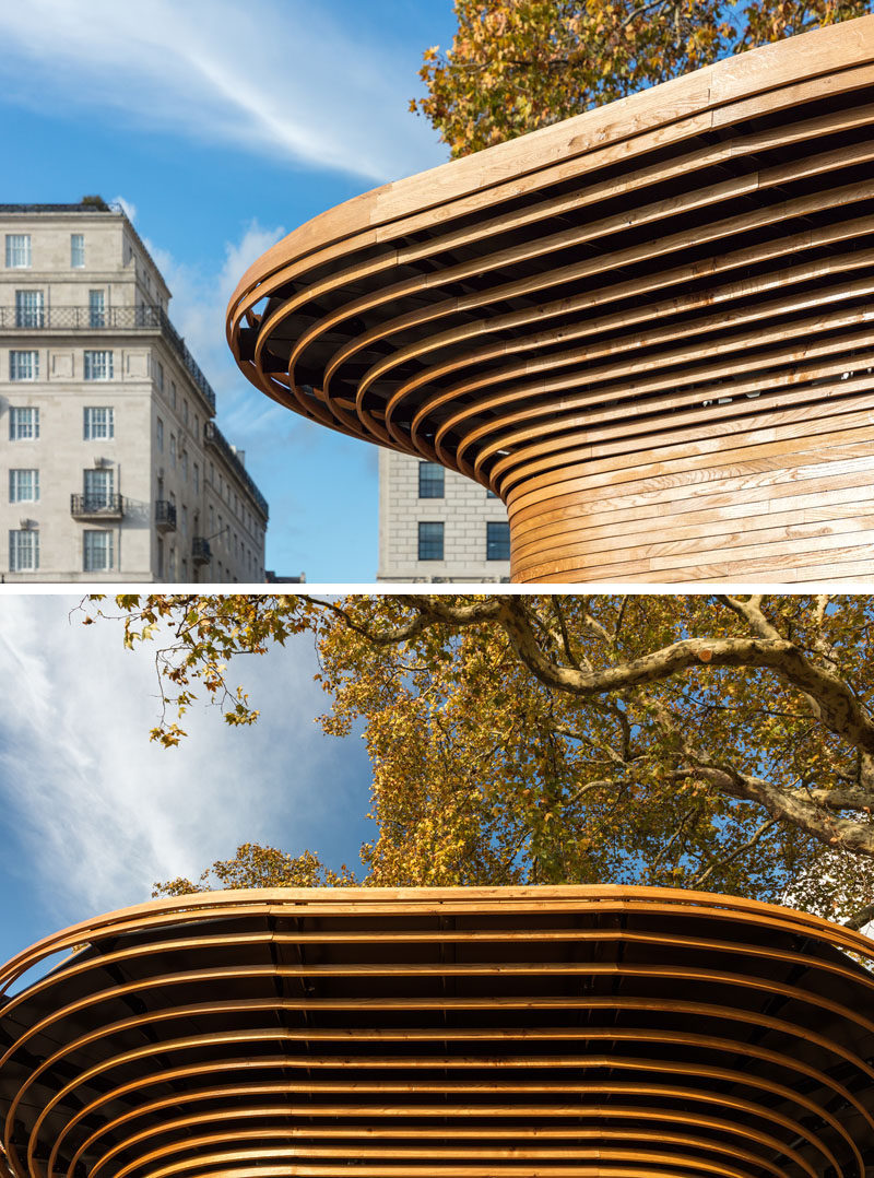 This modern park kiosk features a 360-degree wood sculptural canopy that swells out like a tree's crown creating a recognizable silhouette within the park. #Architecture #ParkKiosk #Wood