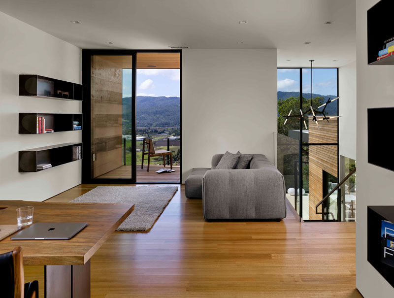 At the top of the stairs in this modern house, is an open home office and sitting room with access to a balcony. #HomeOffice #SittingRoom #Balcony