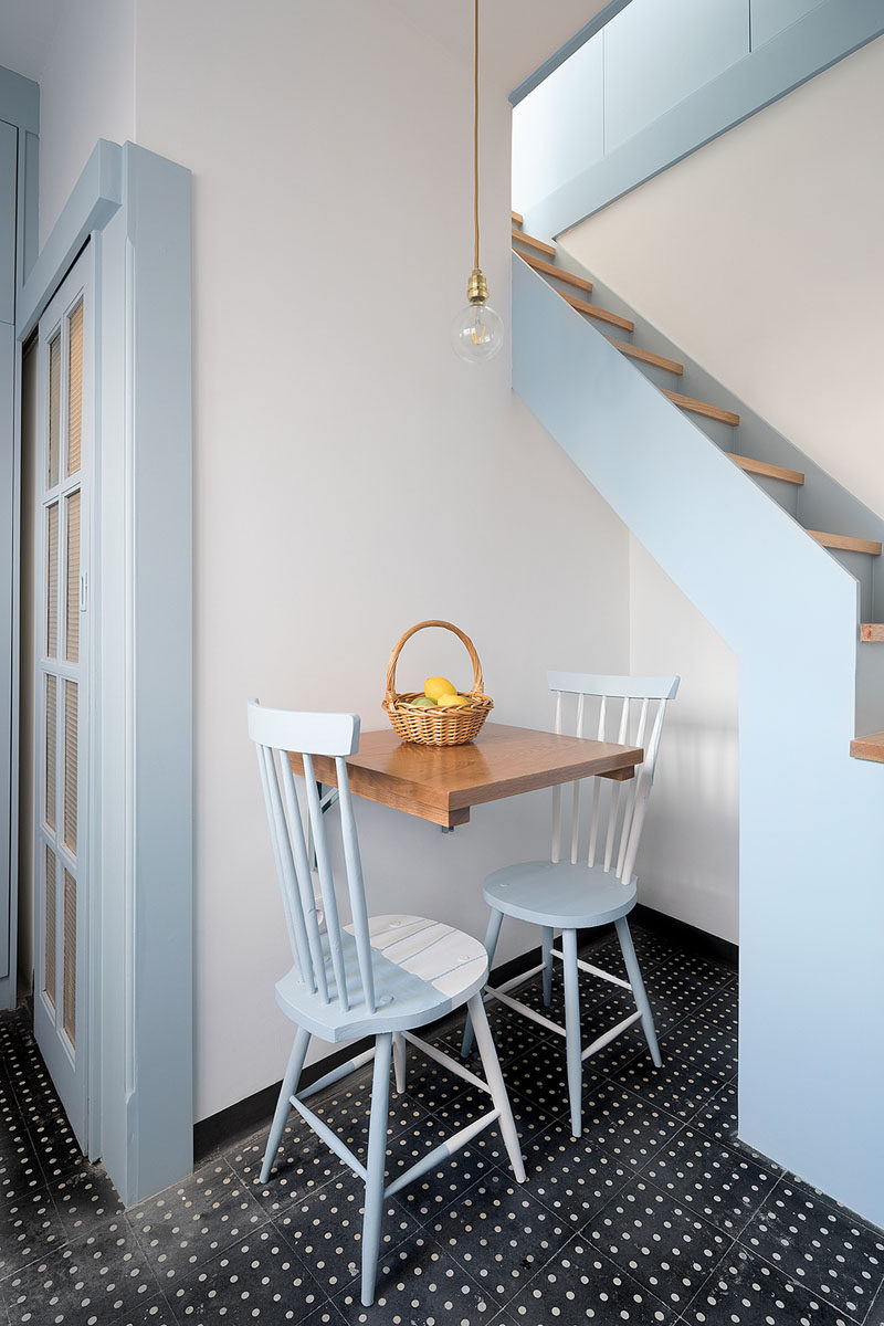 This small dining area for two partially tucks into an alcove underneath the stairs. #Dining #SmallLiving #TinyHouse