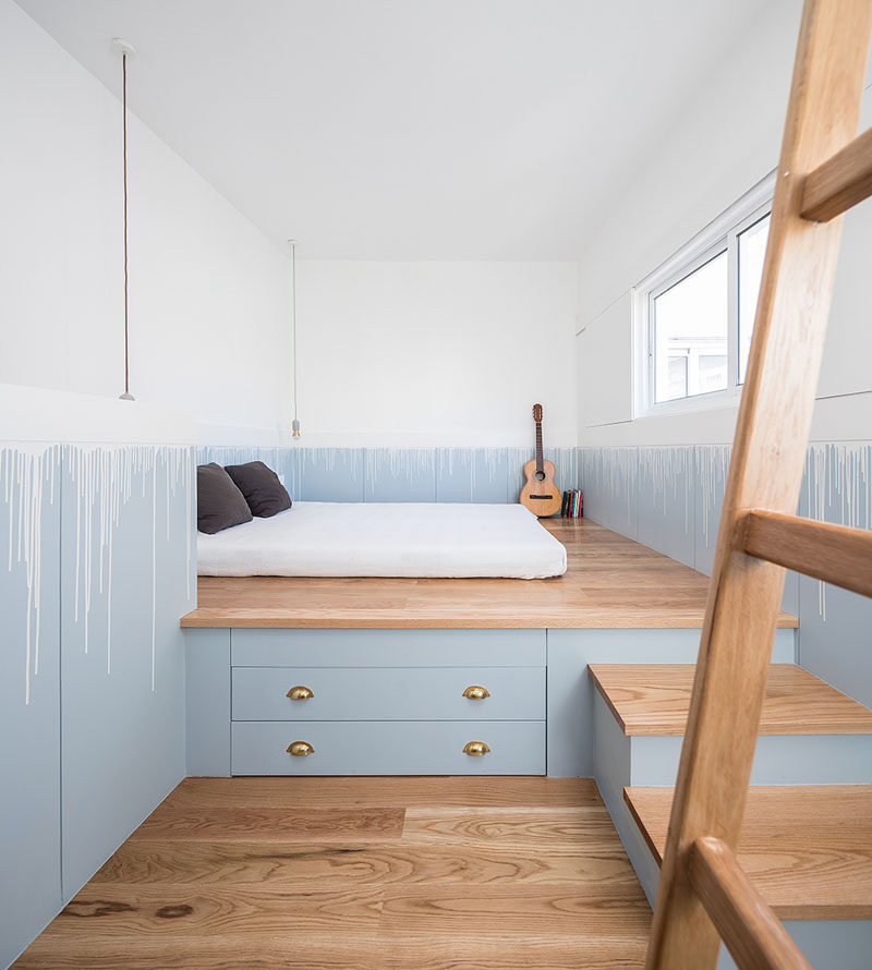 The bed has been raised up onto a custom-designed wood platform, that provides much needed storage in this tiny house. #PlatformBed #BedroomDesign